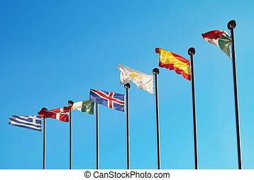 European flags - Row of european flags against blue sky...