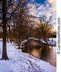 Winter view of a creek at sunset, in rural Frederick County,...