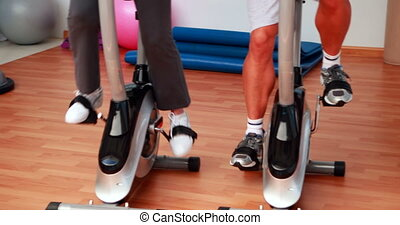 Group doing a spinning class at the gym