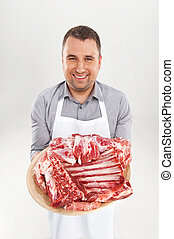 young chef holding raw meat professional butcher showing...