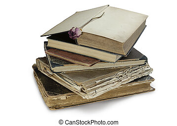 Book pile - A pile of old books with one open