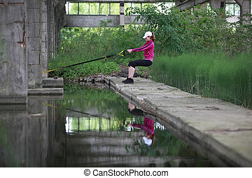 woman on suspension training - woman on the outdoor...