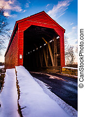 Winter view of Loy's Station Covered Bridge in rural...