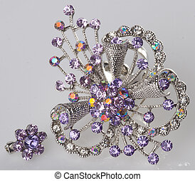 jewellery. brooches on a background - jewellery. brooches on...