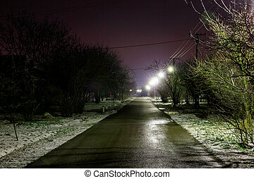 rural road at night with lights
