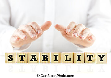 Stability - Conceptual image of a businessman in...