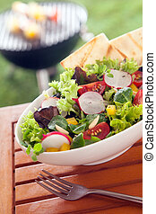 Veggie Healthy fresh vegetarian salad on a picnic table