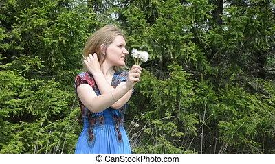 dandelion seed fly woman