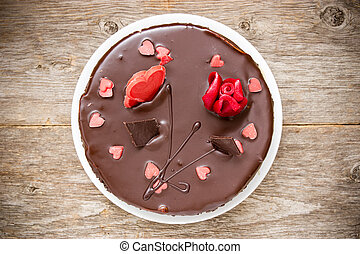 Chocolate cake decorated with  hearts