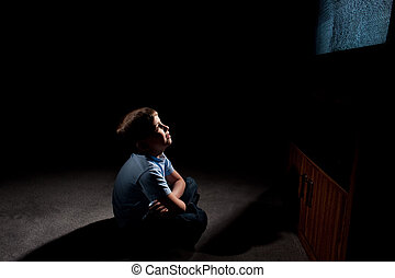 boy in front of tv - Six year old boy watching static on...