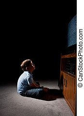 boy watching tv - Six year old boy watching static on...