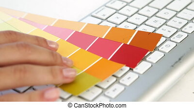 Close up of married woman choosing colours in the office
