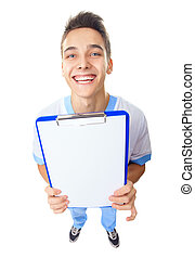 Laughing young doctor showing empty clipboard - Wide angle...