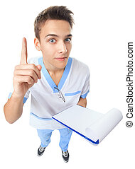 Young doctor pointing a good idea - Wide angle top view of...