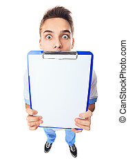 Surprised young doctor showing empty clipboard - Wide angle...