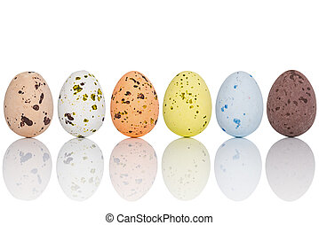 Candy covered Easter eggs in a line isolated - Six candy...