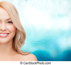 face of calm young woman - heath and beauty concept -...