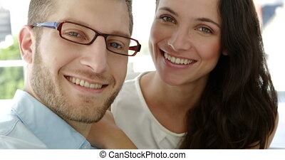 Portrait of attractive coworkers smiling at camera in the...