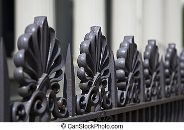 Rod Iron Fence - A rod iron fence in front of a southern...