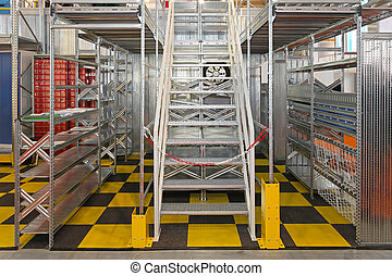 Storage room with metal shelves and racks