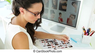 Cute businesswoman working with pictures