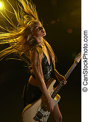 Rocking out! - Young attractive rock girl playing the...