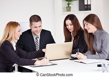 Business Team - Four happy Business people looking project...