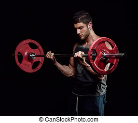 athletic young man exercising in the gym