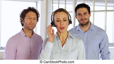 Blonde female agent working with headphones