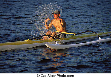 Man refreshing while canoeing