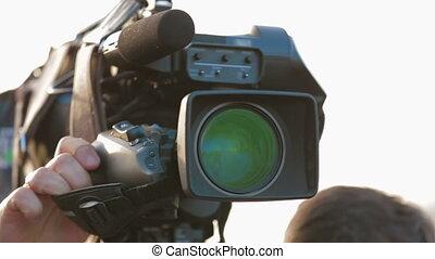 Cameraman working outdoors Close-up