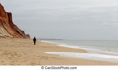 Tourists walking in falesia beach - Tourists walking in...