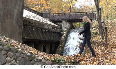 woman leaves waterfall