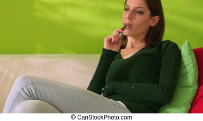 woman smoking electronic cigarette - young female smoker...