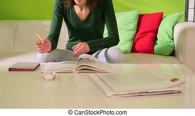 female student doing homeworks - young caucasian student...