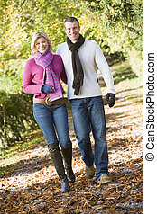 Young couple on autumn walk - Young couple on walk through...