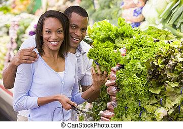 Couple buying fresh produce in supermarket