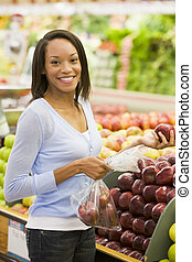 Young woman shopping for fresh produce