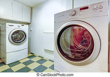 White laundry room with green and olive concrete tile floor...
