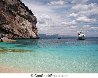 Boat arriving on Sardinia - Boat arriving on a beach of...