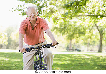 Senior man on cycle ride in countryside