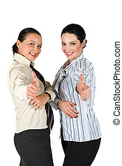 Two business woman giving thumbs up - Two beautiful business...