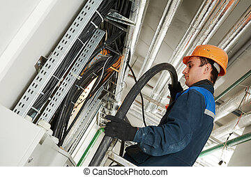 electrician worker at cabling - electrician builder engineer...