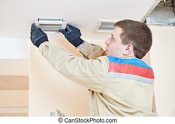 ventilation engineer worker - industrial builder installing...