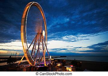 Merry-go-round at night (motion blur of lights) - Amusement...