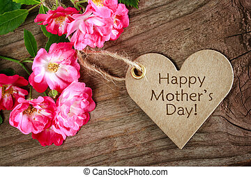 Heart shaped mothers day card with roses on wood background
