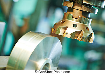 Close-up process of metal machining by mill - industrial...