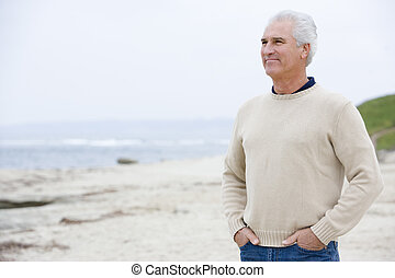 Man at the beach with hands in pockets