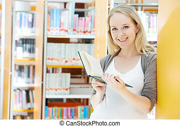 young woman with book in library
