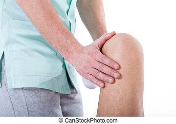 Knee rehabilitation closeup - A closeup of a doctor...